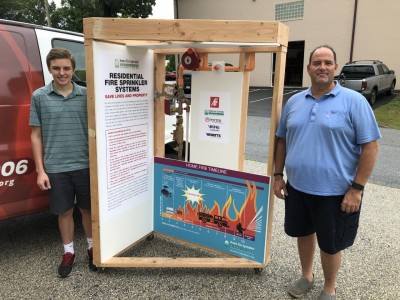 AGF Intern Ryan Overton (Left) and Jim McHugh (right) with a completed NFPA 13D Display